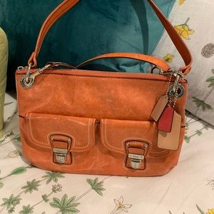 Coach messenger handbag/tangerine orange color